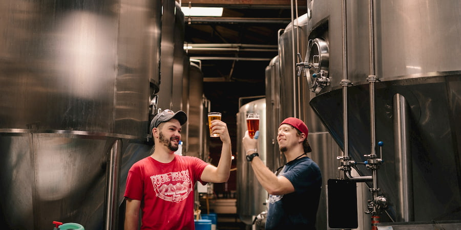 two beer fans sample craft beer in a brewery