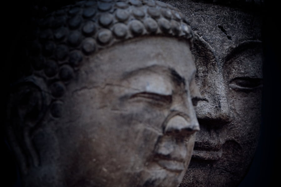 closeup of two Buddha statue faces
