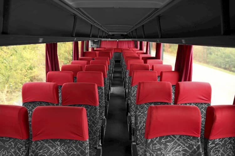 Charter bus interior with gray and red seats