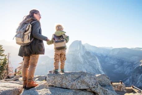 A woman and young boy hiking at Yosemite National Park