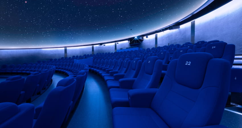 interior of a planetarium, stars projected on the cieling