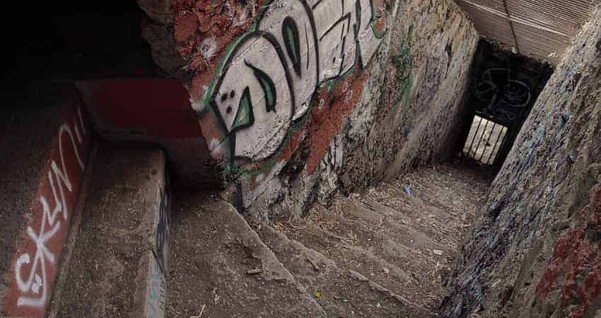 A stairwell to an old animal enclosure covered with graffiti at the Old Griffith Park Zoo