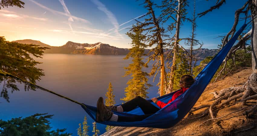 A visitor in a hammock overlooking Crater Lake