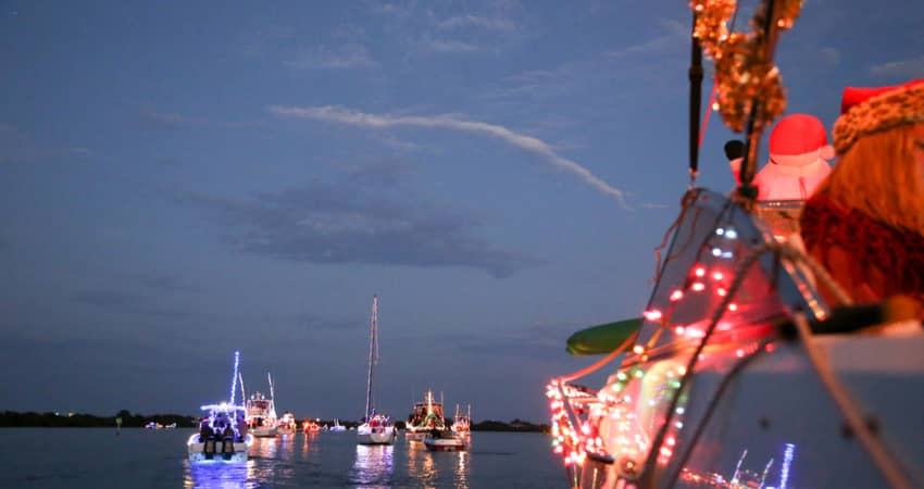 A holiday boat parade with decorations
