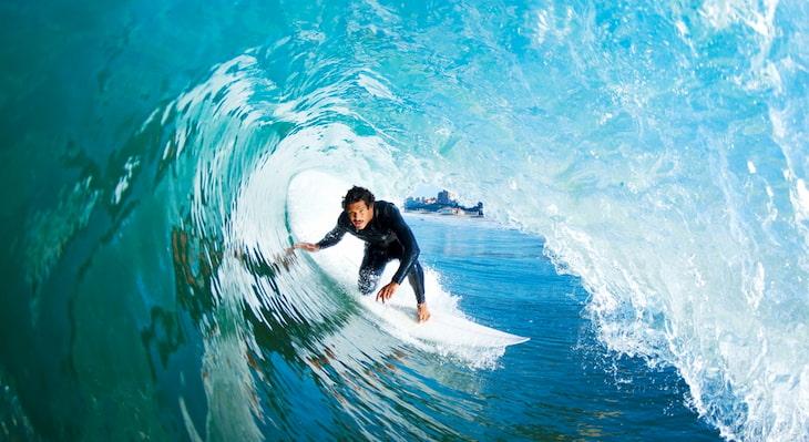 A surfer zooms through a barrel wave near Maverick's Beach in California